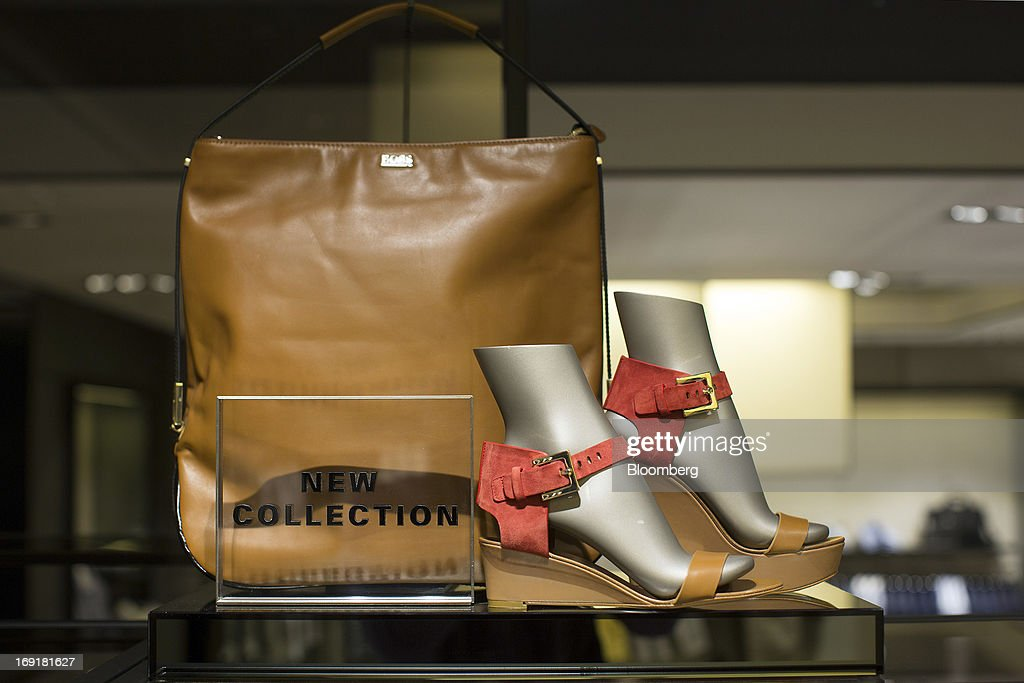 Ladies shoes and a shoulder bag sit displayed for sale inside Hugo Boss AG's store on Regent Street in London, U.K. on Tuesday, May 21, 2013. Hugo Boss AG reiterated its earnings forecast for the year after the German luxury-clothing maker said its retail business increased sales by 14 percent in the first quarter as it opened more outlets. Photographer: Simon Dawson/Bloomberg via Getty Images
