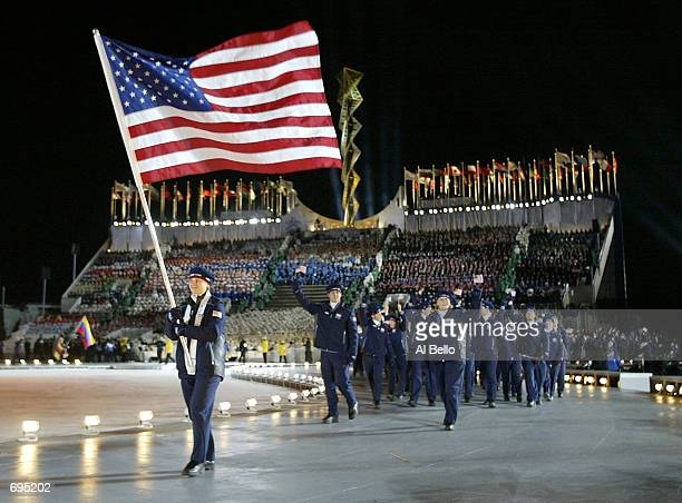 Ladies short track speed skater Amy Peterson carries the American flag at the Opening Ceremony of the 2002 Salt Lake City Winter Olympic Games at the...