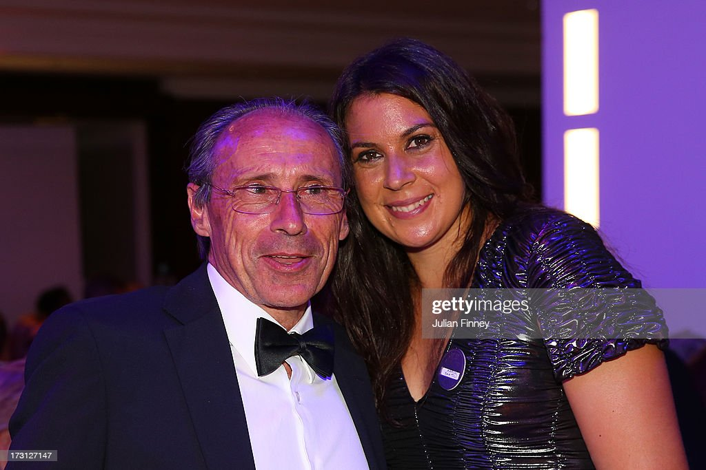 Ladies' Singles champion, <a gi-track='captionPersonalityLinkClicked' href=/galleries/search?phrase=Marion+Bartoli&family=editorial&specificpeople=227896 ng-click='$event.stopPropagation()'>Marion Bartoli</a> of France poses with her father Walter Bartoli at the Wimbledon Championships 2013 Winners Ball at InterContinental Park Lane Hotel on July 7, 2013 in London, England.