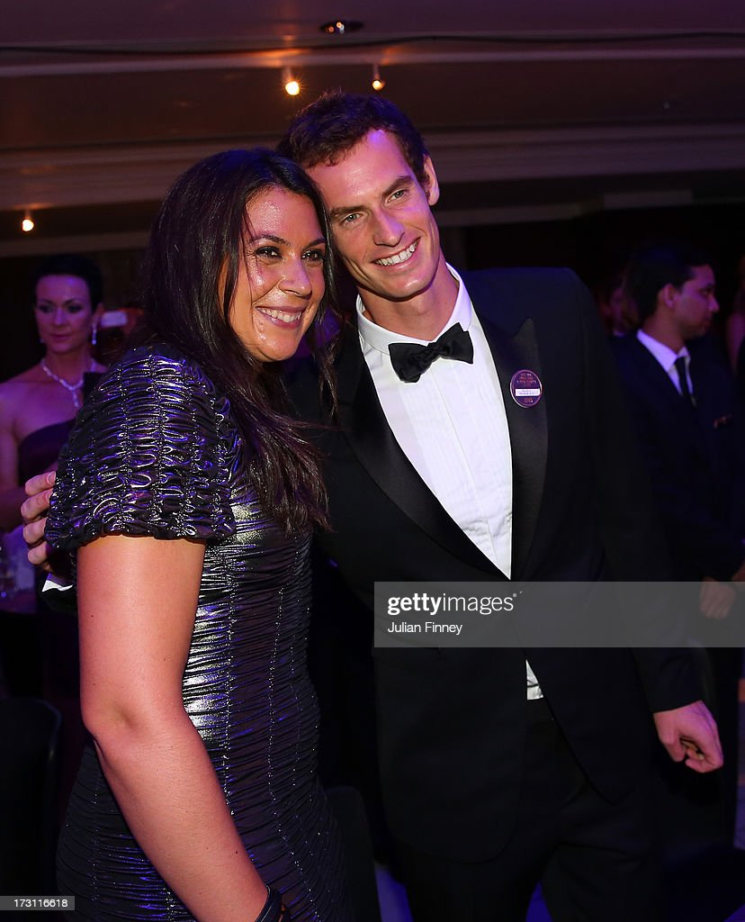 Ladies' Singles Champion <a gi-track='captionPersonalityLinkClicked' href=/galleries/search?phrase=Marion+Bartoli&family=editorial&specificpeople=227896 ng-click='$event.stopPropagation()'>Marion Bartoli</a> of France poses with Gentlemen's Singles champion Andy Murray of Great Britain at the Wimbledon Championships 2013 Winners Ball at InterContinental Park Lane Hotel on July 7, 2013 in London, England.