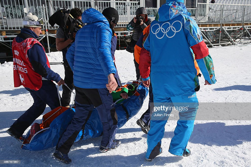 Ladies snowboarder Marika Enne of Finland crash landed on the final jump of the slopestyle course and is seen on a stretcher during a training session at Rosa Khutor Extreme Park prior to the Sochi 2014 Winter Olympics at the Mountain Cluster on February 4, 2014 in Sochi, Russia.