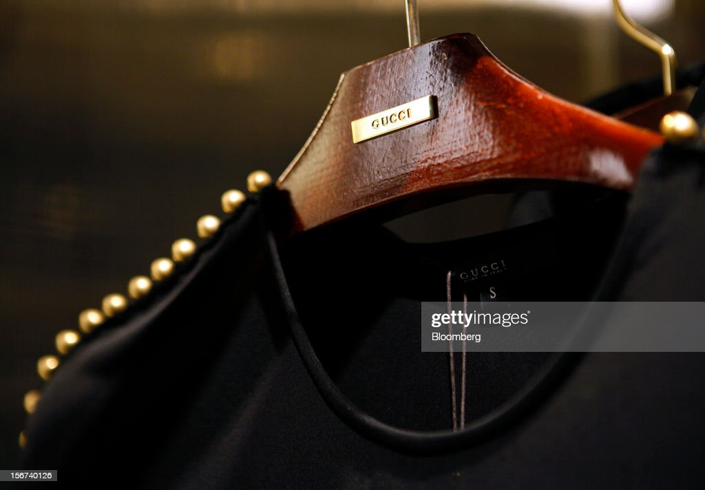 A ladies top hangs on a branded clothes hanger inside a Gucci store, a luxury unit of France's PPR SA, in Rome, Italy, on Monday, Nov. 19, 2012. PPR SA, the French owner of the Gucci and Puma brands, said it's confident of revenue and profit growth in 2012. Photographer: Alessia Pierdomenico/Bloomberg via Getty Images