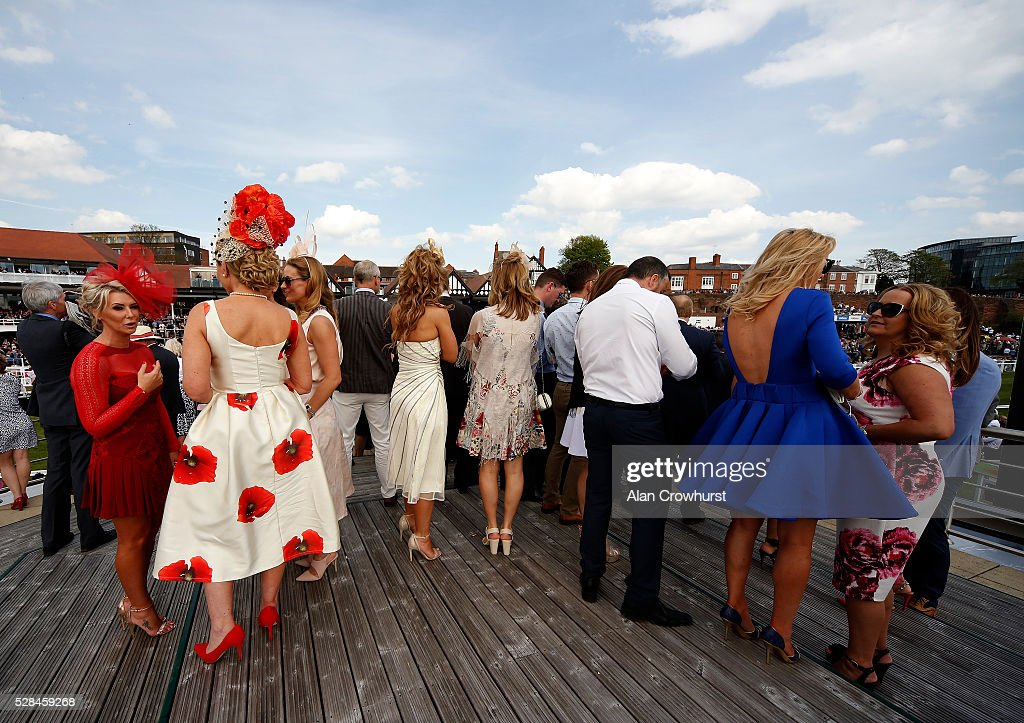 Ladies view the racing from on top of the press room at Chester racecourse on May 5, 2016 in Chester, England.
