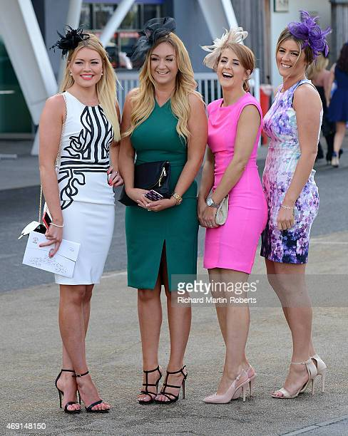 Ladies wearing hats enjoy the atmosphere on Day 2 of the Aintree races at Aintree Racecourse on April 10 2015 in Liverpool England