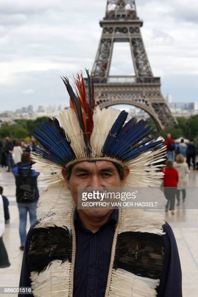 Ladio Veron a leader of Brazil's indigenous Guarani Kaiowa tribe stands in front of the Eiffel tower on May 20 2017on the Parvis des Droits de...