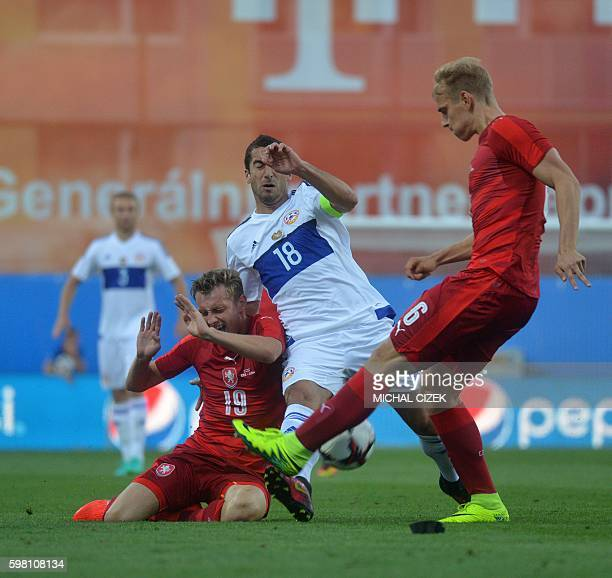 Ladislav Krejci and Lukas Pokorny both of Czech Republic vie for the ball with Henrik Mchitarjan of Armenia during the friendly soccer match bettween...