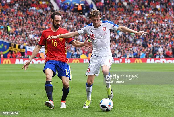Ladislav Krejci of Czech Republic and Juanfran of Spain compete for the ball during the UEFA EURO 2016 Group D match between Spain and Czech Republic...