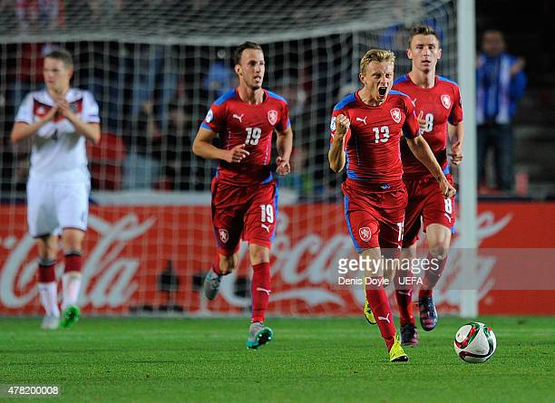 Ladislav Krejci of Czech Republic celebrates with teammates after scoring his team's opening goal during the UEFA Under 21 Group A match between...