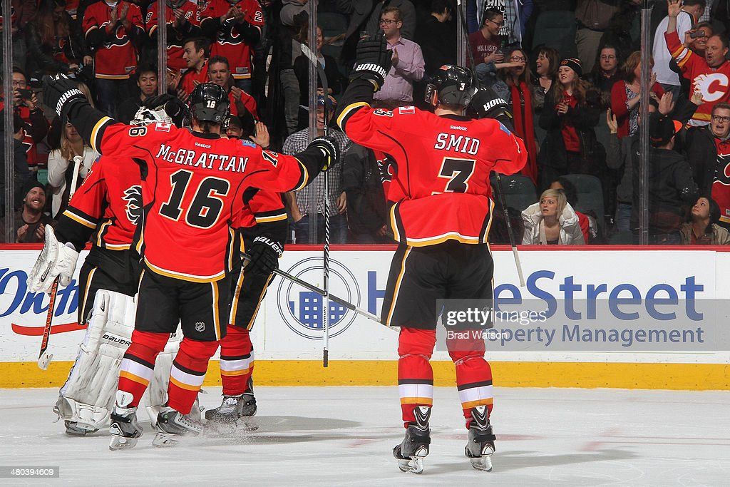Ladislav Smid #3 and Brian McGrattan #16 of the Calgary Flames celebrate a win with Karri Ramo #31 in a game against the San Jose Sharks at Scotiabank Saddledome on March 24, 2014 in Calgary, Alberta, Canada.