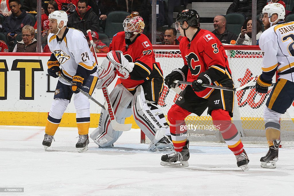 Ladislav Smid #3 and <a gi-track='captionPersonalityLinkClicked' href=/galleries/search?phrase=Joni+Ortio&family=editorial&specificpeople=4779725 ng-click='$event.stopPropagation()'>Joni Ortio</a> #37 of the Calgary Flames defend the net against <a gi-track='captionPersonalityLinkClicked' href=/galleries/search?phrase=Eric+Nystrom&family=editorial&specificpeople=2209813 ng-click='$event.stopPropagation()'>Eric Nystrom</a> #24 of the Nashville Predators at Scotiabank Saddledome on March 21, 2014 in Calgary, Alberta, Canada.