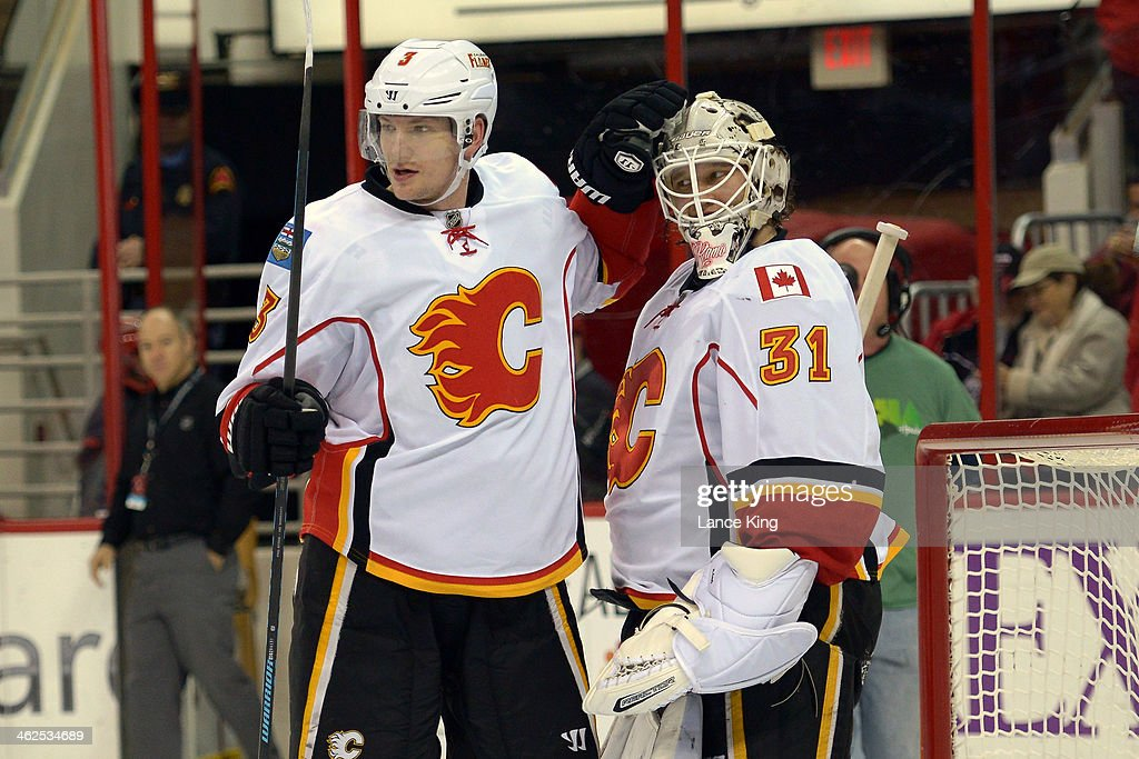 Ladislav Smid and Karri Ramo of the Calgary Flames celebrate following their game against the Carolina Hurricanes at PNC Arena on January 13 2014 in...