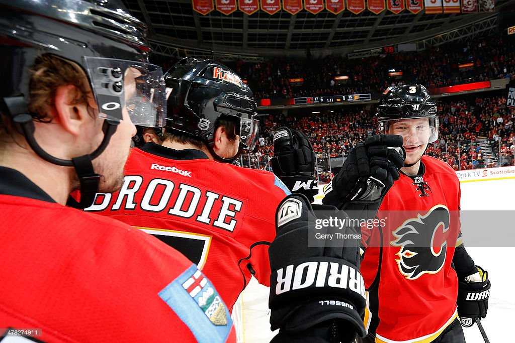 Ladislav Smid #3 of the Calgary Flames celebrates a goal with his teammates against the Anaheim Ducks at Scotiabank Saddledome on March 12, 2014 in Calgary, Alberta, Canada.