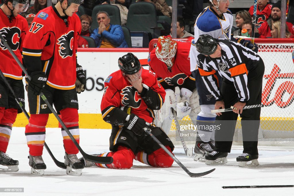 Ladislav Smid of the Calgary Flames is injured in a game against the St Louis Blues at Scotiabank Saddledome on December 23 2013 in CalgaryAlberta...
