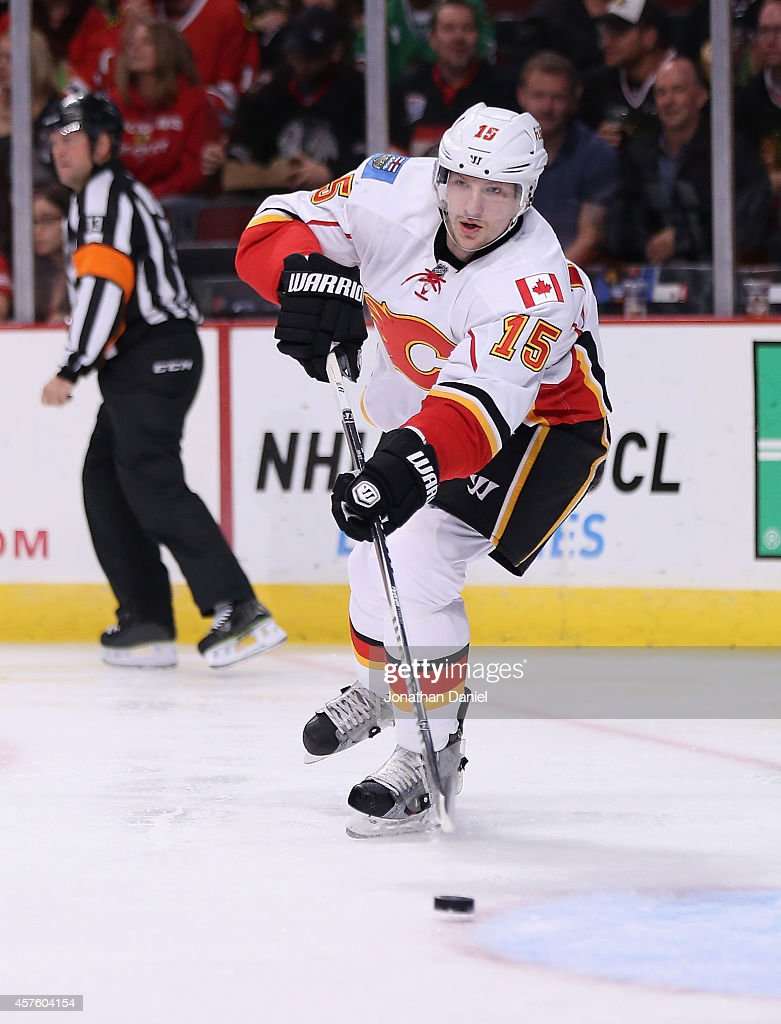 Ladislav Smid of the Calgary Flames passes against the Chicago Blackhawks at the United Center on October 15 2014 in Chicago Illinois The Flames...