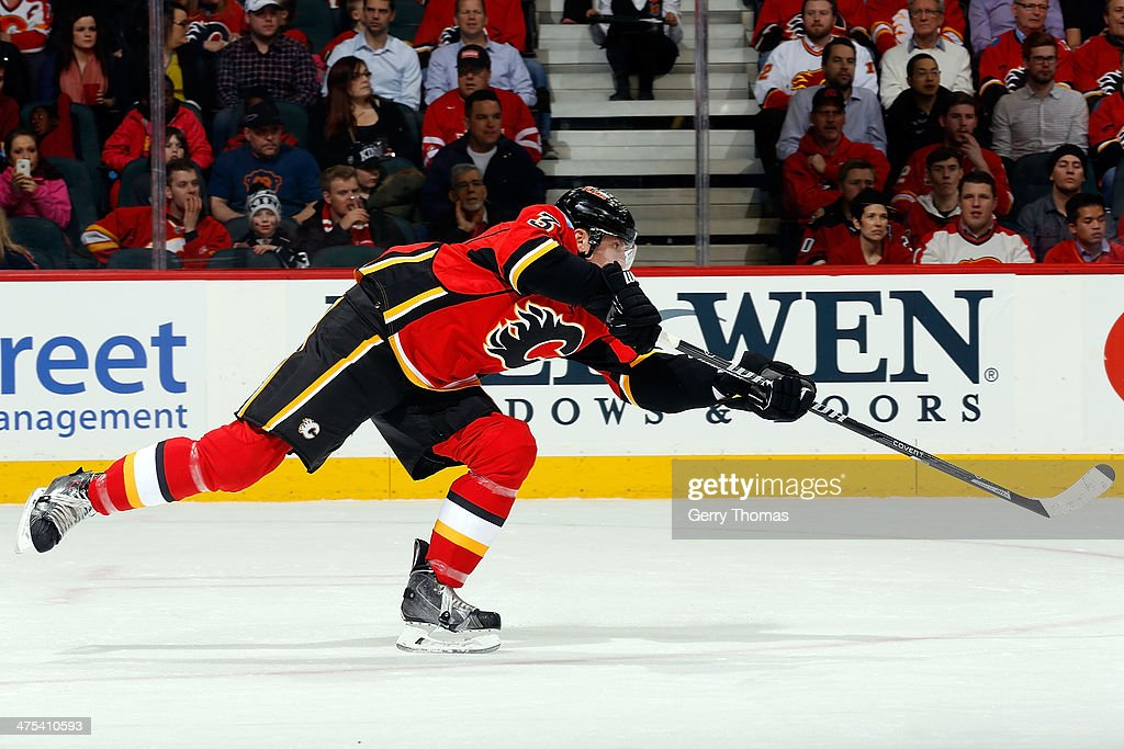 Ladislav Smid of the Calgary Flames shoots the puck against the Los Angeles Kings at Scotiabank Saddledome on February 27 2014 in Calgary Alberta...
