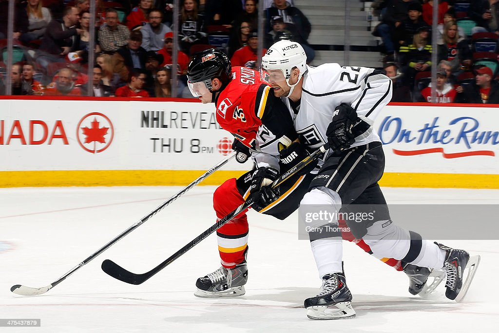 Ladislav Smid #3 of the Calgary Flames skates against <a gi-track='captionPersonalityLinkClicked' href=/galleries/search?phrase=Trevor+Lewis&family=editorial&specificpeople=543187 ng-click='$event.stopPropagation()'>Trevor Lewis</a> #22 of the Los Angeles Kings at Scotiabank Saddledome on February 27, 2014 in Calgary, Alberta, Canada.