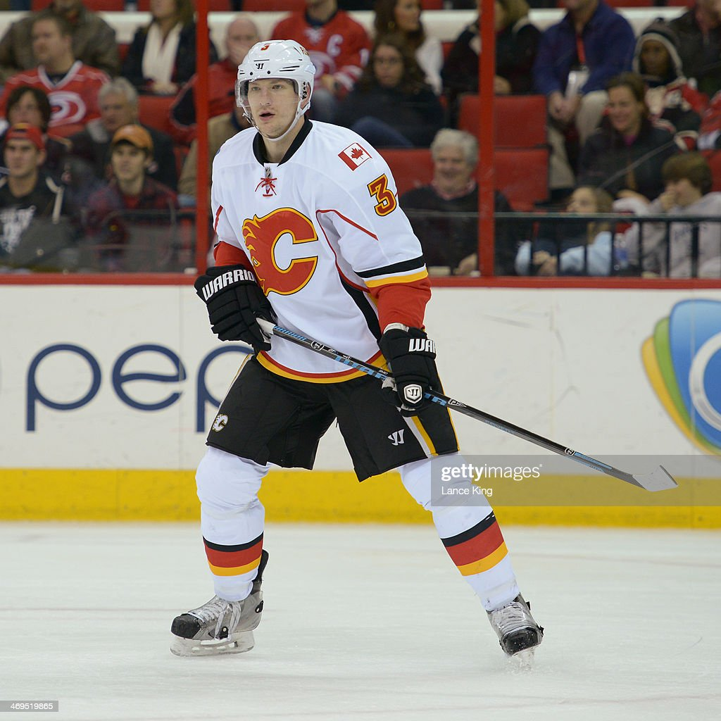 Ladislav Smid of the Calgary Flames skates on the ice against the Carolina Hurricanes at PNC Arena on January 13 2014 in Raleigh North Carolina The...