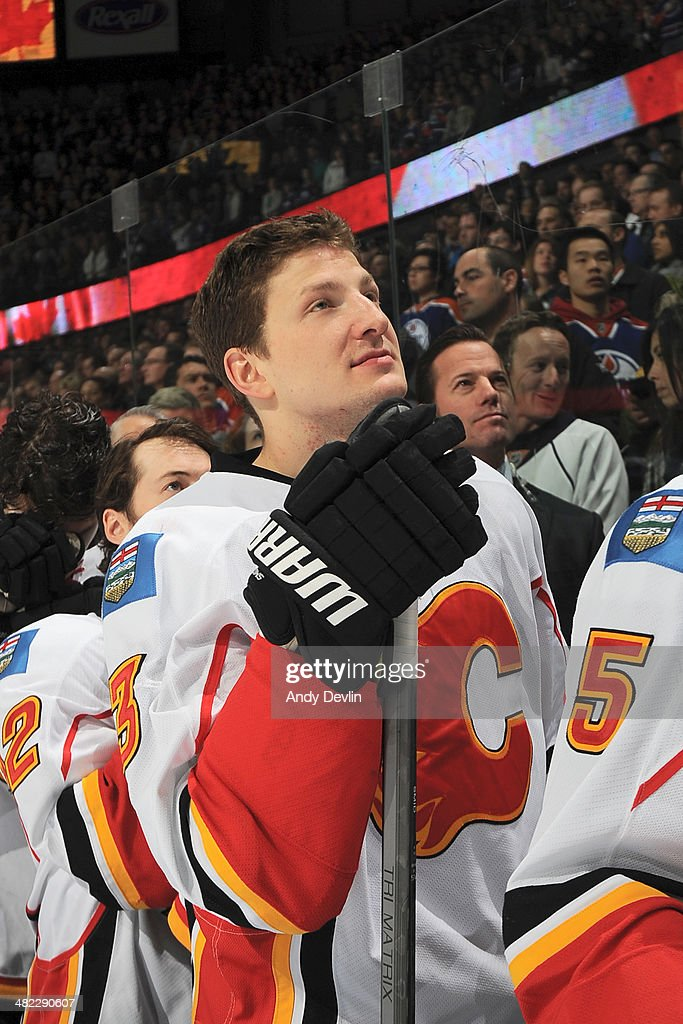 Ladislav Smid of the Calgary Flames stands for the singing of the national anthem prior to a game against the Edmonton Oilers on March 22 2014 at...