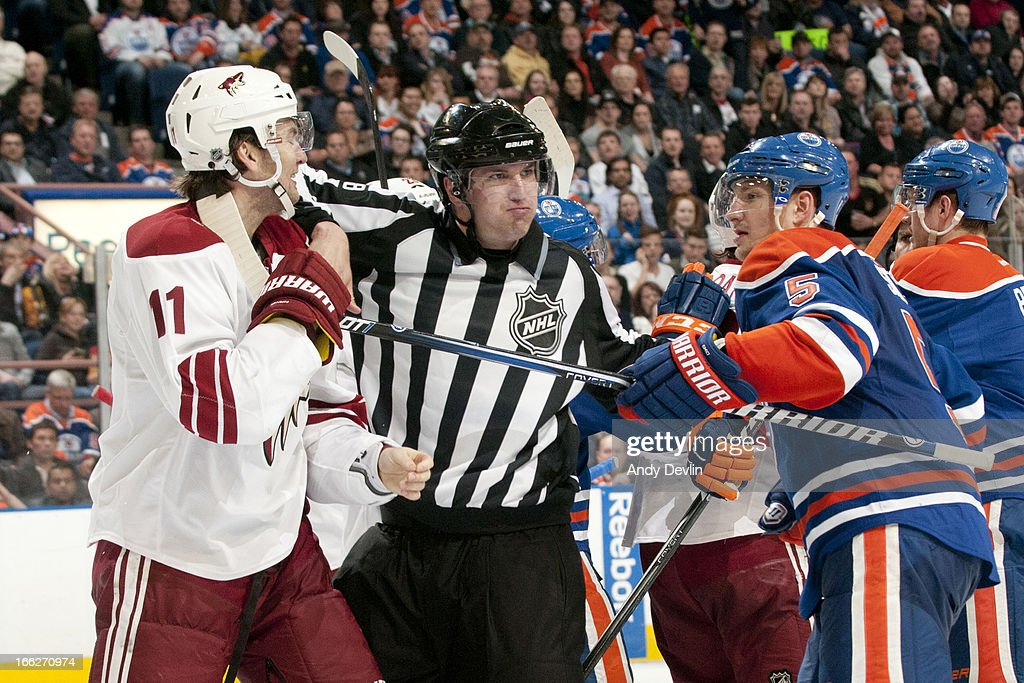 Ladislav Smid #5 of the Edmonton Oilers and <a gi-track='captionPersonalityLinkClicked' href=/galleries/search?phrase=Martin+Hanzal&family=editorial&specificpeople=2109469 ng-click='$event.stopPropagation()'>Martin Hanzal</a> #11 of the Phoenix Coyotes tangle on April 10, 2013 at Rexall Place in Edmonton, Alberta, Canada.