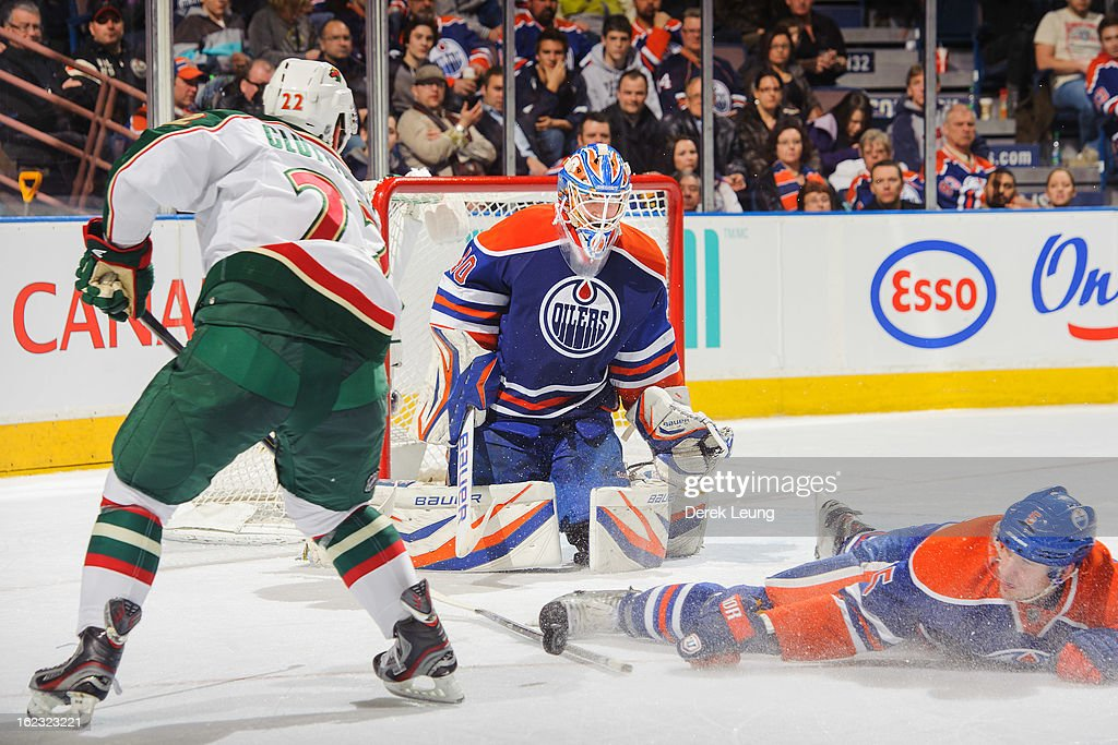 Ladislav Smid #5 of the Edmonton Oilers deflects the shot of Cal Clutterbuck #22 of the Minnesota Wild during an NHL game at Rexall Place on February 21, 2013 in Edmonton, Alberta, Canada.