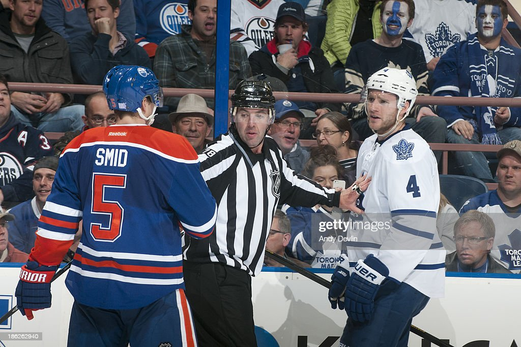 Ladislav Smid #5 of the Edmonton Oilers exchanges words with <a gi-track='captionPersonalityLinkClicked' href=/galleries/search?phrase=Cody+Franson&family=editorial&specificpeople=2125769 ng-click='$event.stopPropagation()'>Cody Franson</a> #4 of the Toronto Maple Leafs on October 29, 2013 at Rexall Place in Edmonton, Alberta, Canada.