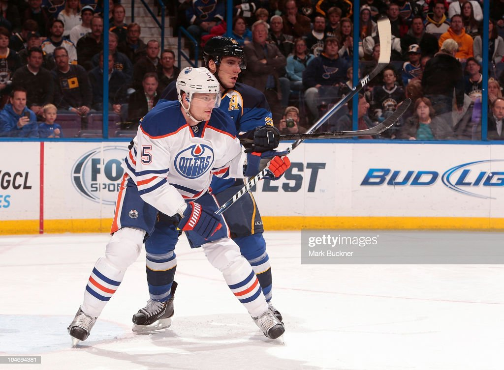 Ladislav Smid #5 of the Edmonton Oilers skates against <a gi-track='captionPersonalityLinkClicked' href=/galleries/search?phrase=Alexander+Steen&family=editorial&specificpeople=600136 ng-click='$event.stopPropagation()'>Alexander Steen</a> #20 of the St. Louis Blues in an NHL game on March 26, 2013 at Scottrade Center in St. Louis, Missouri.