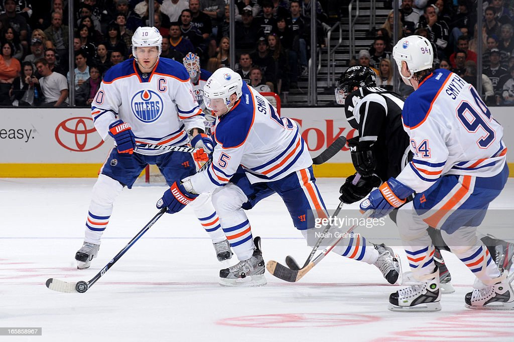<a gi-track='captionPersonalityLinkClicked' href=/galleries/search?phrase=Ladislav+Smid&family=editorial&specificpeople=716738 ng-click='$event.stopPropagation()'>Ladislav Smid</a> #5 of the Edmonton Oilers skates with the puck against Justin Williams #14 of the Los Angeles Kings at Staples Center on April 6, 2013 in Los Angeles, California.