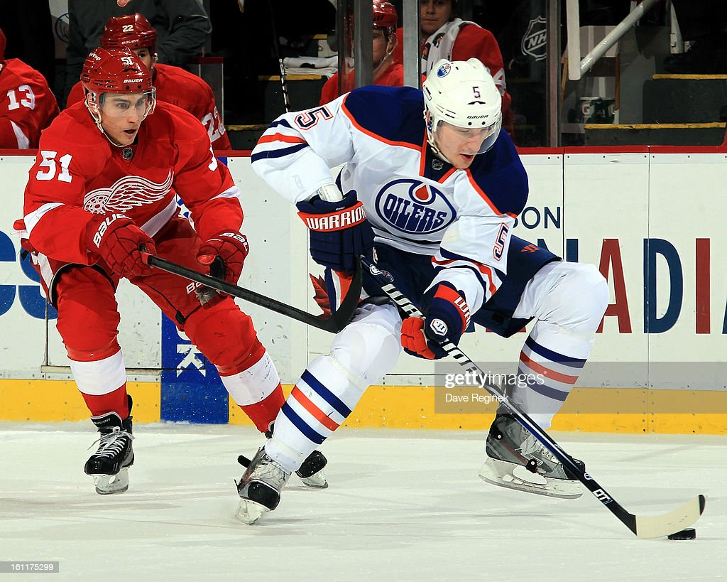 Ladislav Smid #5 of the Edmonton Oilers skates with the puck as <a gi-track='captionPersonalityLinkClicked' href=/galleries/search?phrase=Valtteri+Filppula&family=editorial&specificpeople=2234404 ng-click='$event.stopPropagation()'>Valtteri Filppula</a> #51 of the Detroit Red Wings gives chase during a NHL game at Joe Louis Arena on February 9, 2013 in Detroit, Michigan.