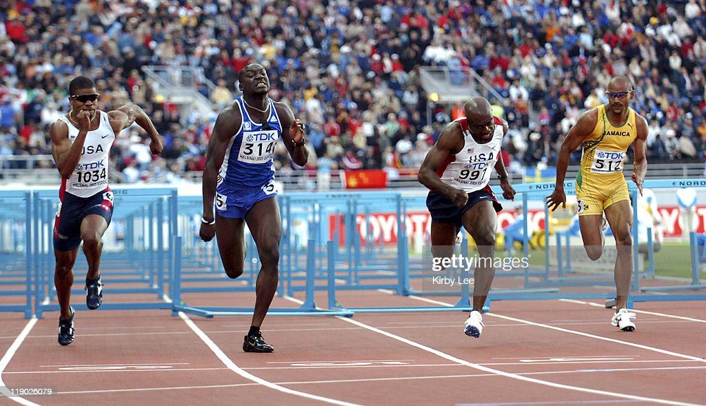 Ladji Doucoure of France (314) holds off Terrence Trammell (1034) and Allen Johnson (997) to win the 110-meter high hurdles in13.07 in the IAAF World Championships in Athletics at Olympic Stadium in Helsinki, Finland on Friday, August 12, 2005. Johnson was third in 13.10. Trammell was fifth in 13.20. Jamaica's Maurice Wignall (right) was seventh in 13.47.