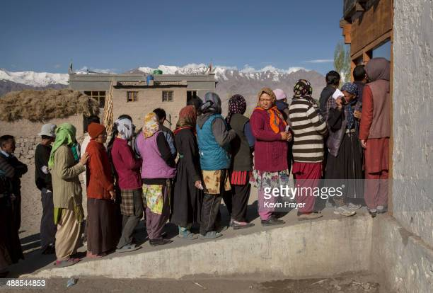 Ladkahis wait outside a polling station to vote near the Thiksey Monastery on May 7 2014 in Thiksey Ladakh India India is in the midst of a nine...