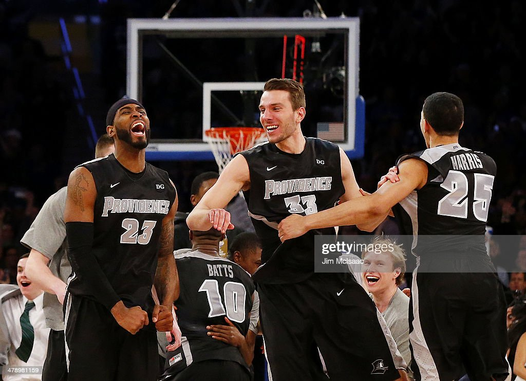 LaDontae Henton Carson Desrosiers and Tyler Harris of the Providence Friars celebrate their 65 to 58 win over the Creighton Bluejays during the...