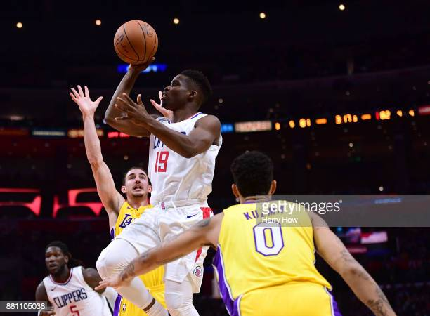 LaDontae Henton of the LA Clippers drives to the basket between Alex Caruso and Kyle Kuzma of the Los Angeles Lakers during a 111104 Laker win at...