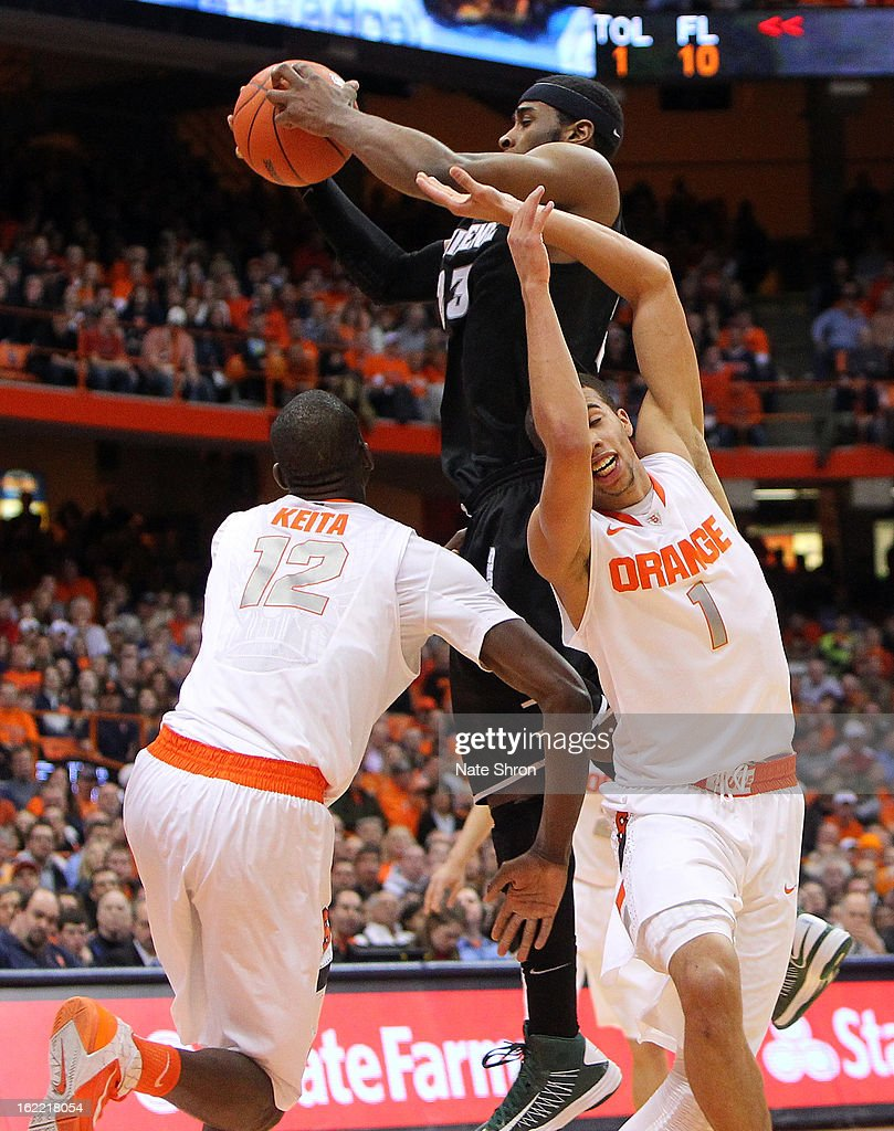 LaDontae Henton #23 of the Providence Friars grabs a rebound against Baye Moussa-Keita #12 and Michael Carter-Williams #1 of the Syracuse Orange during the game at the Carrier Dome on February 20, 2013 in Syracuse, New York.