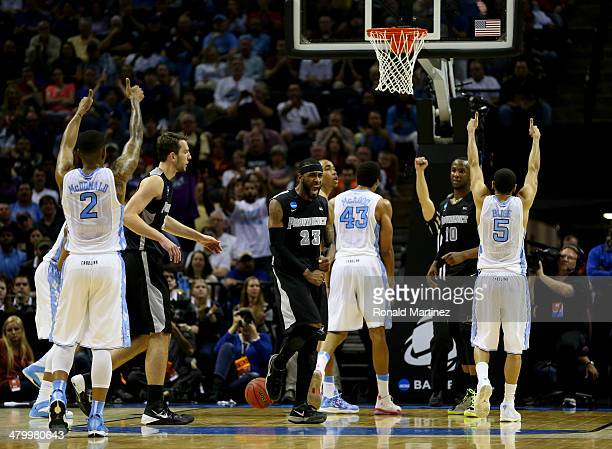 LaDontae Henton of the Providence Friars reacts after James Michael McAdoo of the North Carolina Tar Heels hit a free throw during the closing...