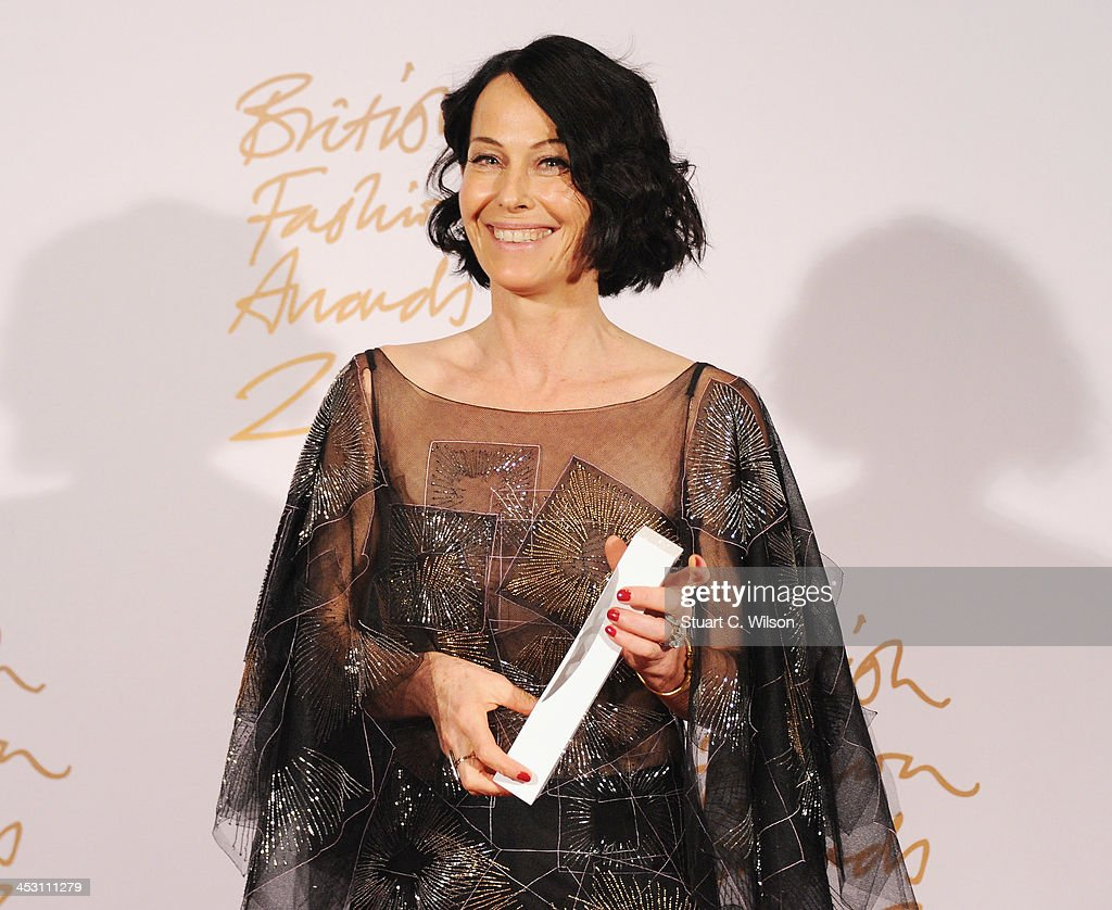 Lady Amanda Harlech with the Isabella Blow Award for Fashion Creator poses in the winners room at the British Fashion Awards 2013 at London Coliseum on December 2, 2013 in London, England.