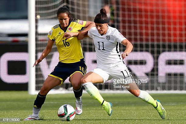 Lady Andrade of Colombia and Alex Krieger of the United States go after the ball in the FIFA Women's World Cup 2015 Round of 16 match at Commonwealth...