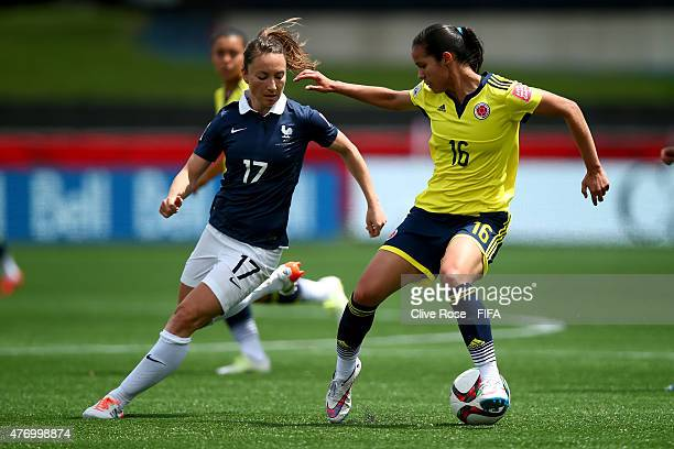 Lady Andrade of Colombia is challenged by Gaetane Thiney of France during the FIFA Women's World Cup 2015 Group F match between France and Colombia...