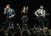 Lady Antebellum Charles Kelley Hillary Scott and Dave Haywood perform as part of Rebuilding Henryville With Lady Antebellum at the YUM Center on May...