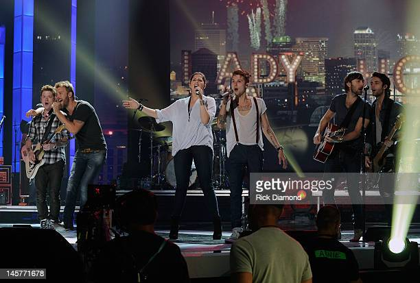 Lady Antebellum members Charles Kelley Hillary Scott and Dave Haywood are joined by Hot Chelle Rae members Nash Overstreet Ryan Follese and Ian...