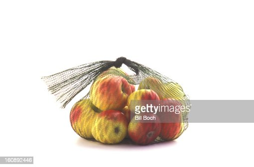 Lady apples in a net bag : Stock Photo
