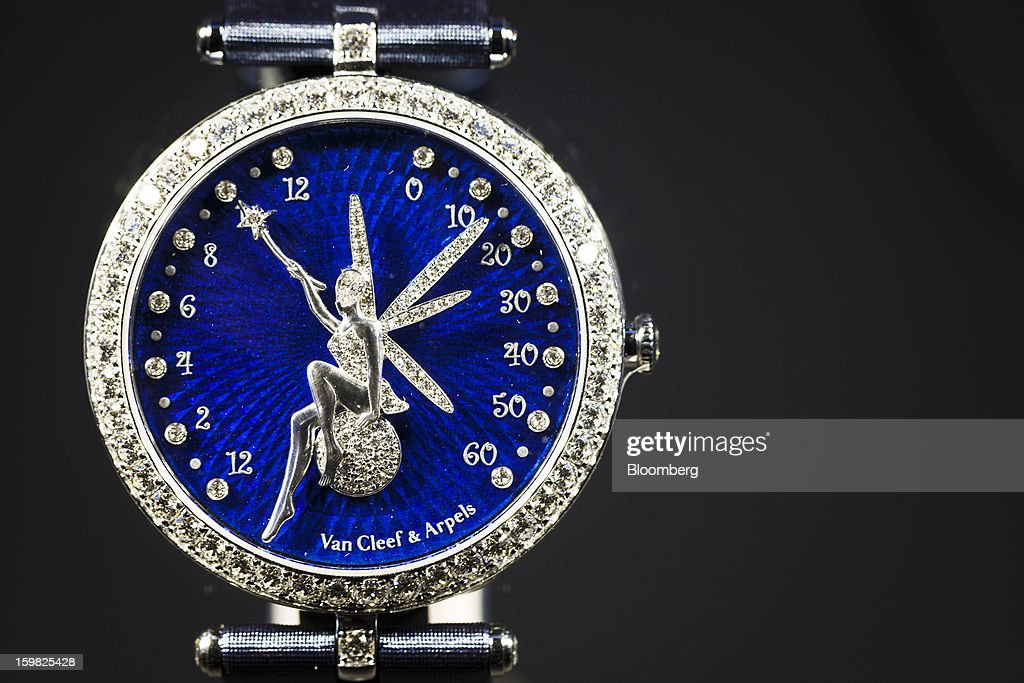 A Lady Arpels Feerie watch manufactured by Van Cleef & Arpels, a unit of Cie. Financiere Richemont SA, sits on display on the first day of the Salon International de la Haute Horlogerie (SIHH) watch fair in Geneva, Switzerland, on Monday, Jan. 21, 2013. The Swiss watch industry slowed in the second half of 2012 as sales of timepieces and jewelry in Hong Kong, the biggest market for Swiss watchmakers, declined in August and October. Photographer: Valentin Flauraud/Bloomberg via Getty Images