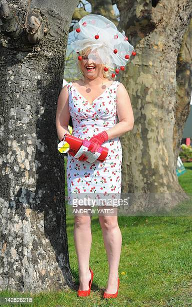 A lady arrives dressed for Ladies' Day during the second day of the Grand National horse racing meeting at Aintree Racecourse in Liverpool northwest...
