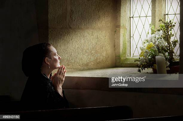 Lady at prayer
