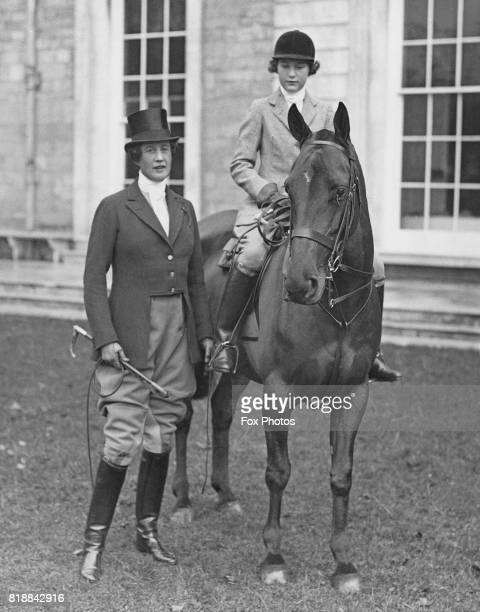 Lady Beatrice Leconfield wife of Charles Henry Wyndham 3rd Baron Leconfield with their adopted daughter Elizabeth at the opening meet of Lord...