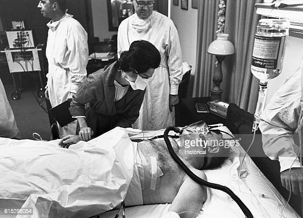 Lady Bird Johnson comforts her husband President Lyndon B Johnson hospitalized at Bethesda Naval Hospital and awating surgery to remove his...