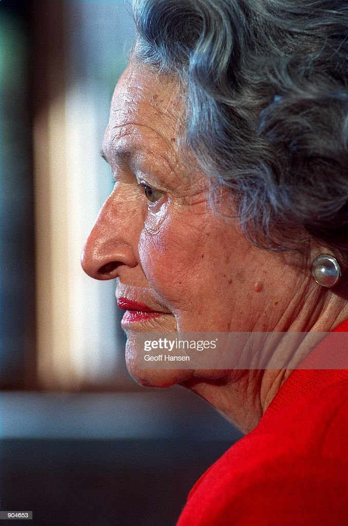 Lady Bird Johnson talks with the media October 8, 1996 during a visit to Woodstock, Vt. The former First Lady is a champion of the environment and in 1982 she founded the National Wildflower Research Center.