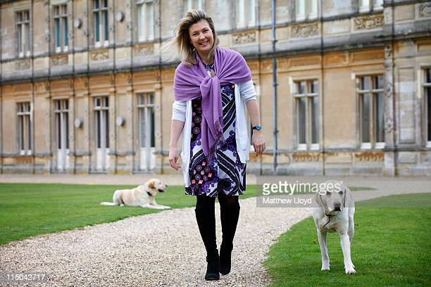 Lady Carnarvon walks her dogs in the grounds of Highclere Castle on March 15 2011 in Newbury England Highclere Castle has been the ancestral home of...