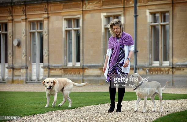 Lady Carnarvon walks the dogs in the grounds of Highclere Castle on March 15 2011 in Newbury England Highclere Castle has been the ancestral home of...
