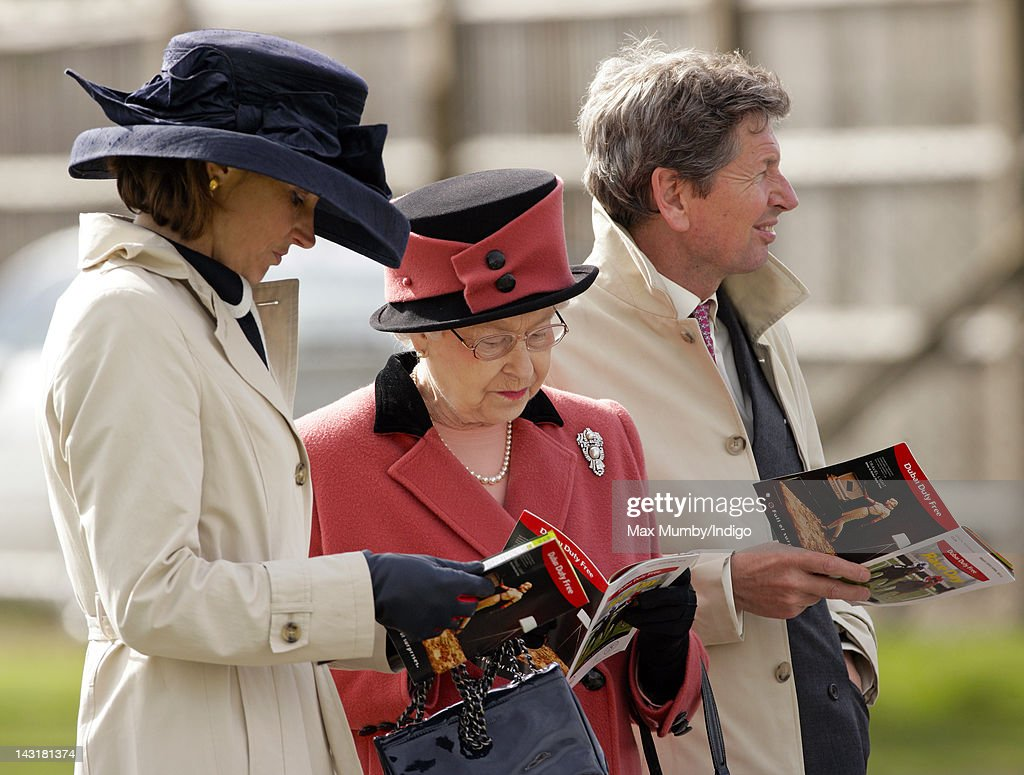 Lady Carolyn Warren, Queen <a gi-track='captionPersonalityLinkClicked' href=/galleries/search?phrase=Elizabeth+II&family=editorial&specificpeople=67226 ng-click='$event.stopPropagation()'>Elizabeth II</a> and <a gi-track='captionPersonalityLinkClicked' href=/galleries/search?phrase=John+Warren+-+Racing+Advisor&family=editorial&specificpeople=14677107 ng-click='$event.stopPropagation()'>John Warren</a> (Queen <a gi-track='captionPersonalityLinkClicked' href=/galleries/search?phrase=Elizabeth+II&family=editorial&specificpeople=67226 ng-click='$event.stopPropagation()'>Elizabeth II</a>'s racing manager) attend the Dubai Duty Free Race Day at Newbury Racecourse on April 20, 2012 in Newbury, England.
