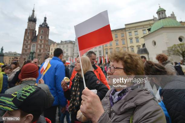 A lady carrying a Polish flag on Poland's Flag Day Flag Day was introduced to Poland in 2004 bridging the gap between International Workers' Day on...